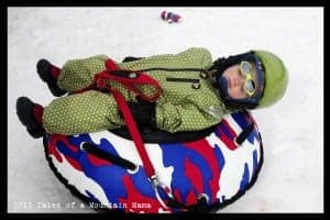 It's a rough life going down the hill and being pulled up every time. Wears a kid out! He's really and truly asleep...