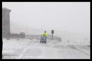 Mtn Papa pushing the kids through the blizzard