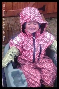 Cheese-ball in his DucKsday rain suit and mittens.