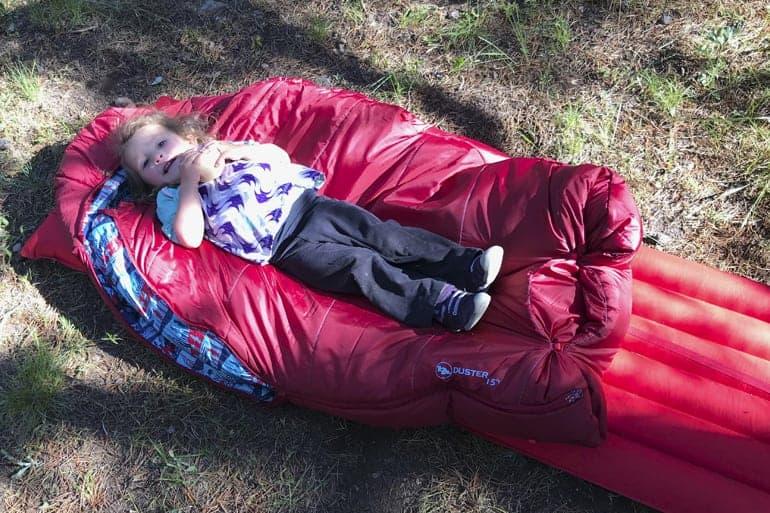 toddler using adult sleeping pad