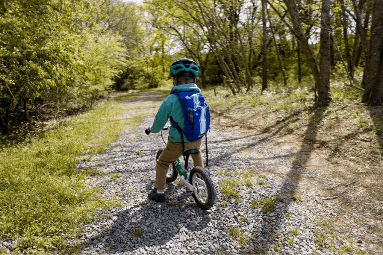 Kid biking with Camelbak Mini MULE hydration backpack