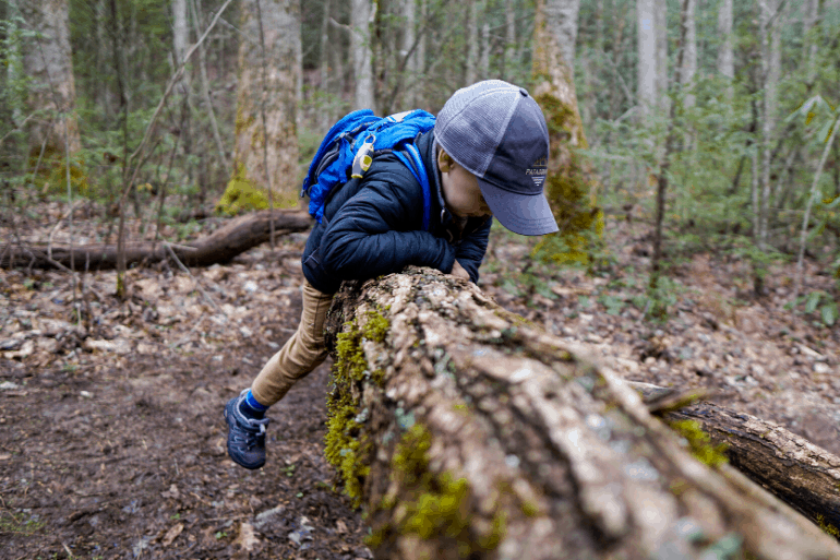 Kid climbing with Camelbak Mini MULE hydration backpack