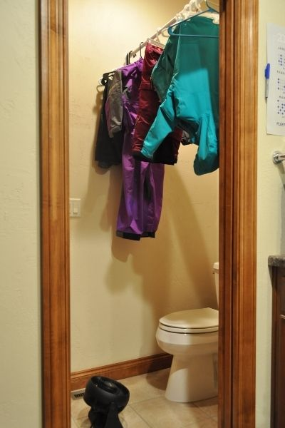 Organizing Your Mudroom for Winter by hanging gear where you can