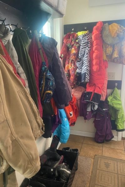 Organizing Your Mudroom for Winter with lots of hooks