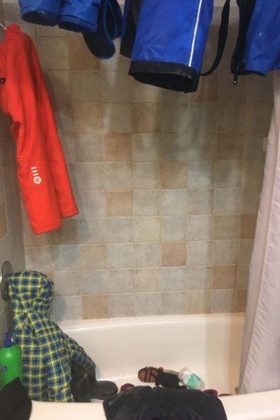 dry winter gear in the bathtub