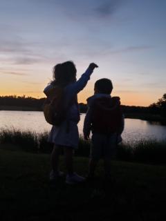 Kids at the lake at night